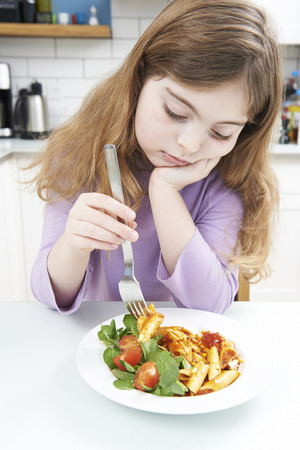 fussy: Fussy Girl With Healthy Meal At Home