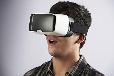 virtual reality simulator: Young Man Wearing Virtual Reality Headset