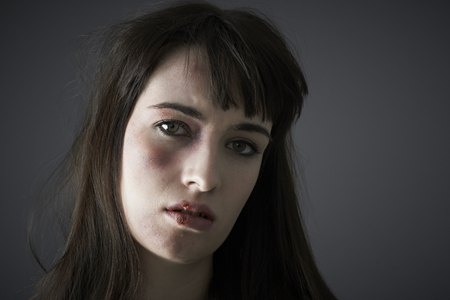 intimidated: Female Victim Of Domestic Abuse Stock Photo
