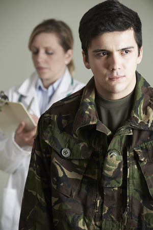 counsellor: Soldier Being Assessed By Doctor Stock Photo