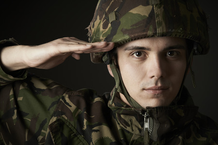 Portrait Of Soldier In Uniform Saluting