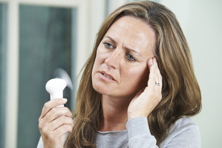 MENOPAUSE: Mature Woman Experiencing Hot Flush From Menopause