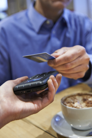 contactless: Customer Using Contactless Payment In Coffee Shop