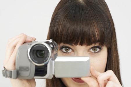 video camera: Woman Recording On Portable Video Camera Stock Photo