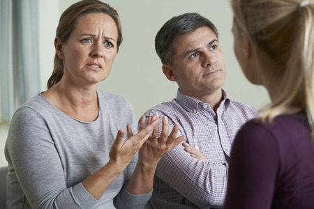 talking: Couple Discussing Problems With Relationship Counsellor