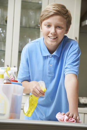 domestic life: Portrait Of Boy Helping to Clean House Stock Photo