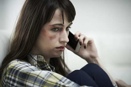 intimidated: Female Victim Of Domestic Abuse Phoning Support Group
