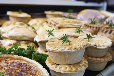 meat counter: Close Up Of Baked Savoury Goods In Delicatessen Stock Photo