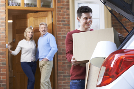 Adult Son Moving Out Of Parent's Home Banco de Imagens