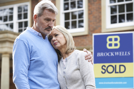 unhappy: Mature Couple Forced To Sell Home Through Financial Problems