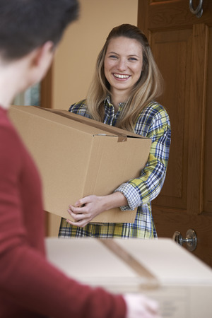 property ladder: Young Couple Moving In To New Home Together Stock Photo