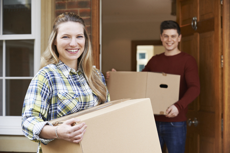people moving: Young Couple Moving In To New Home Together Stock Photo