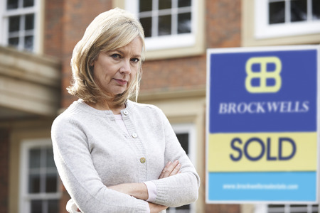 financial problems: Mature Woman Forced To Sell Home Through Financial Problems Stock Photo