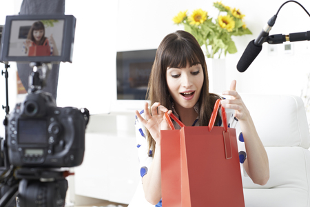 broadcast: Female Vlogger Recording Broadcast At Home Stock Photo
