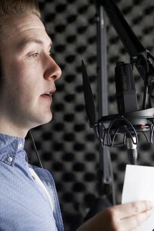 funk music: Man In Recording Studio Talking Into Microphone