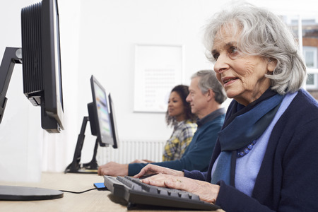 Senior Woman Attending Computer Class