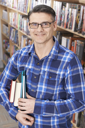 evening class: Mature Male Student Studying In Library Stock Photo