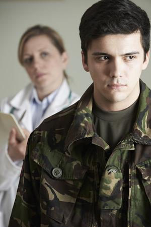assessed: Soldier Being Assessed By Doctor Stock Photo