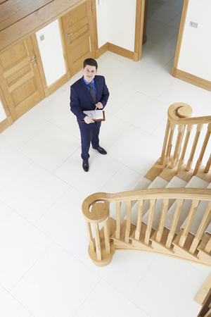 property ladder: Male Realtor Looking Around Vacant New Property