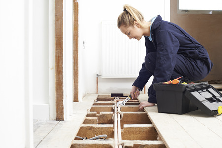 fitting: Female Plumber Fitting Central Heating System Stock Photo