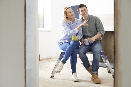 rennovation: Couple Sitting In Property Being Rennovated