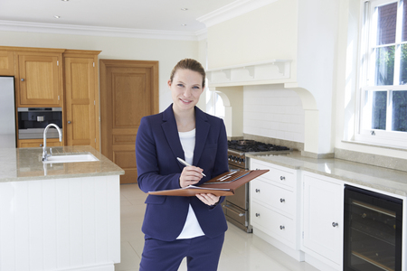 property ladder: Realtor Looking Around Vacant New Property Stock Photo