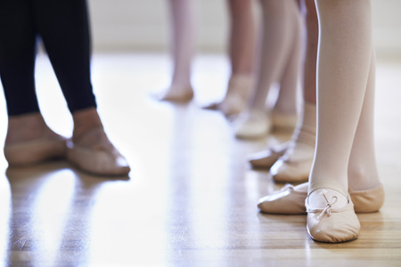 Close Up Of Teacher And Children's Feet In Ballet Dancing Class Imagens