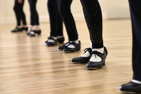 tap dance: Close Up Of Feet In Childrens Tap Dancing Class Stock Photo