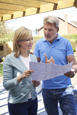 home and garden: Mature Woman Discusses Plan With Landscape Gardener