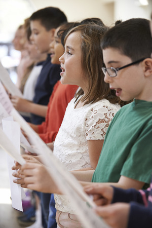 hymn: Group Of School Children Singing In Choir Together
