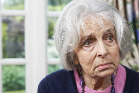head shoulders: Head And Shoulders Portrait Of Unhappy Senior Woman At Home
