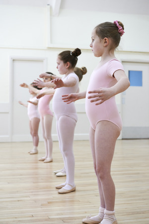 8   9 years: Group Of Young Girls In Ballet Dancing Class