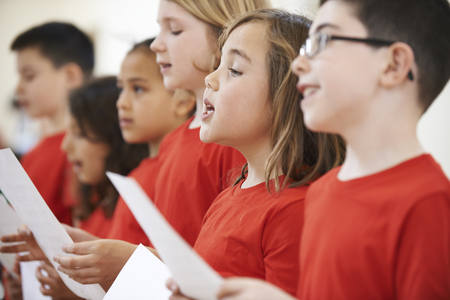 Group Of School Children Singing In Choir Together Stock Photo - 64626267