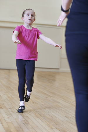 Young Girl Having Tap Dancing Lesson With Teacher
