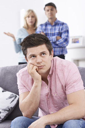 nagging: Mature Parents Frustrated With Adult Son Living At Home