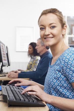 attending: Portrait Of Woman Attending Computer Class Stock Photo