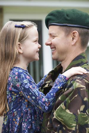 coming together: Soldier On Leave Hugging Daughter