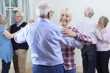 Group Of Seniors Enjoying Dancing Club Together