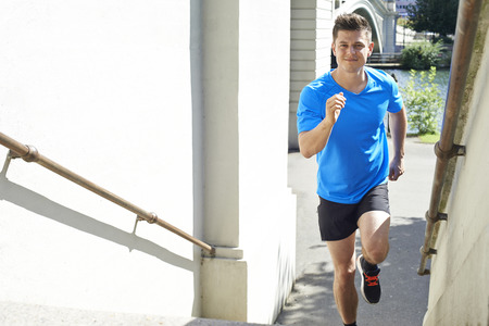 thirties: Young Man Exercising In Urban Environment
