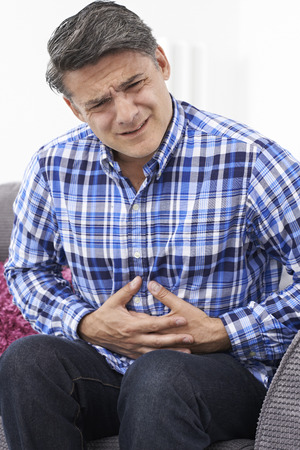 ibs: Mature Man Suffering From Stomach Pain At Home