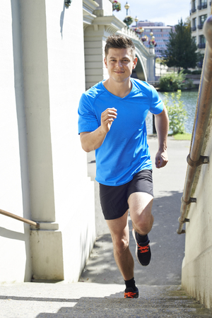 keeping fit: Young Man Exercising In Urban Environment
