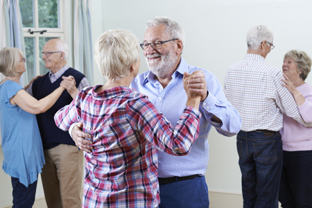 Group Of Seniors Enjoying Dancing Club Together Фото со стока - 64168234