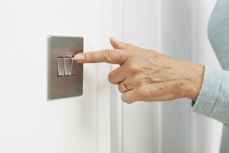 turning off: Close Up Of Woman Turning Off Light Switch