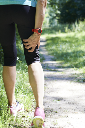 woman in pain: Woman With Sports Injury Sustained Whilst Jogging
