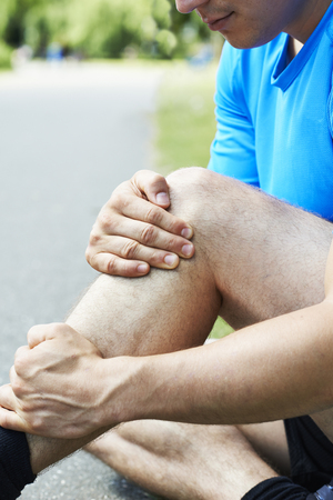 sustained: Man With Sports Injury Sustained Whilst Jogging In Park