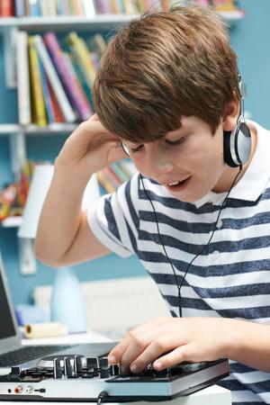 Teenage Boy Mixing Music In Bedroom