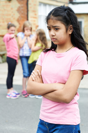 peer pressure: Unhappy Girl Being Gossiped About By School Friends