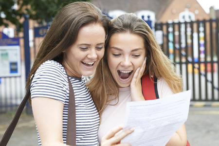 Teenage Girls Celebrating Exam Results Standard-Bild