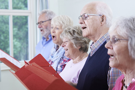 Group Of Seniors Singing In Choir Together Stock Photo - 63089846