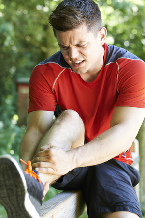 whilst: Man With Sports Injury Sustained Whilst Exercising Outdoors